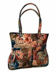 100% Argentinean Floral Leather Slimline Shoulder Bag For $195